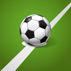 Soccer ball lying on the center of the game field