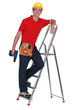 tradesman standing on a stepladder and holding a screw gun