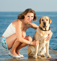 Attractive young woman with dog outdoors