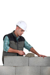 Man spreading mortar with a trowel