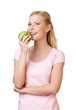 Young woman eating apple, isolated on white background