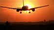 Plane crossing sun at sunrise