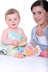 Portrait of a young mum and baby girl