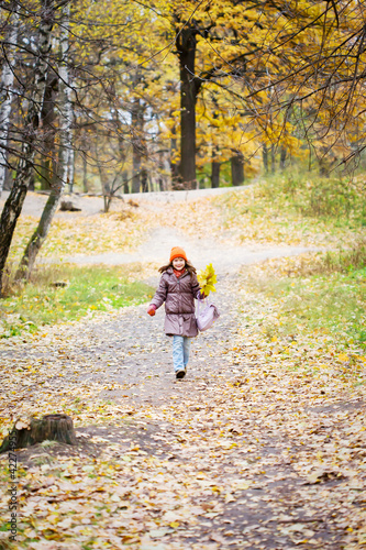 girl in bright yellow autumn forest
