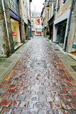 Fototapety old paved road in Dinan