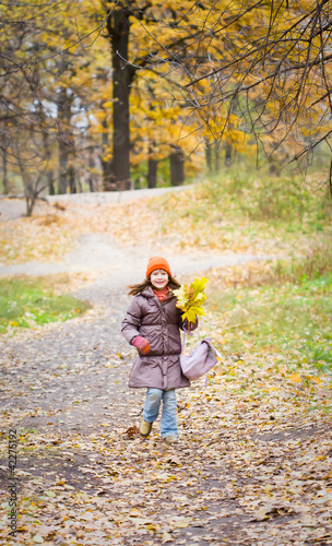 girl in bright autumn forest