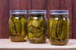 Three jars of pickled cucumbers