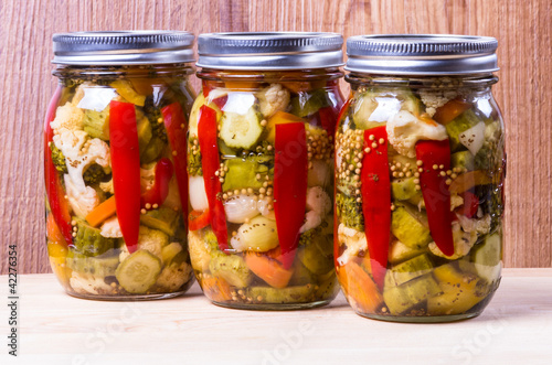 Three jars of preserved mixed vegetables