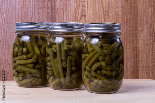 Three jars of preserved pickled beans