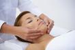 Woman having face massage