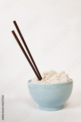 a bowl of rice, chopstick, white background