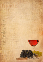 wine in glass and fruit on old paper background
