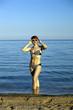 The harmonous woman on the seashore