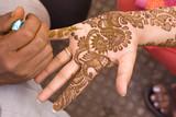 Fototapety applying fresh henna on hand, wedding ,Rajasthan, India