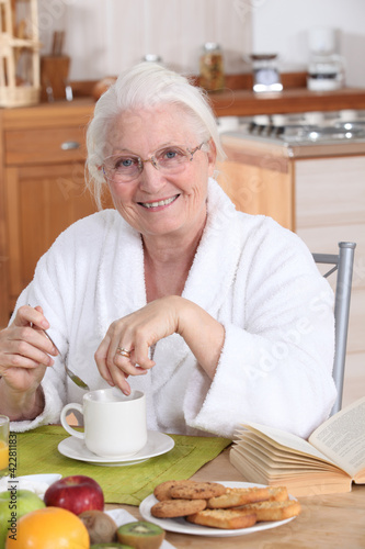 granny in the kitchen having breakfast