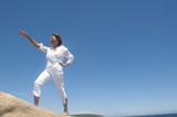 Confident, determined woman on mountain lookout poster
