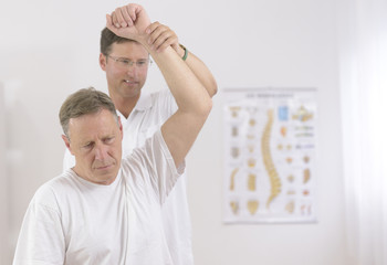 Physiotherapy: Senior man and physiotherapist
