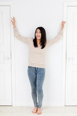 a young asian woman and two doors