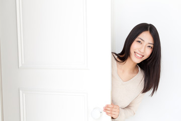 a young asian woman with door