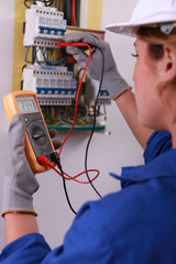 Female electrician with voltmeter
