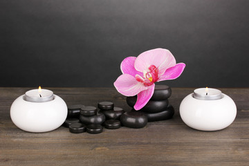 Spa stones with orchid flower and candles