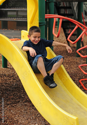 Happy child and slide