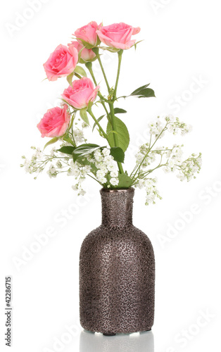 Pink roses in vase isolated on white