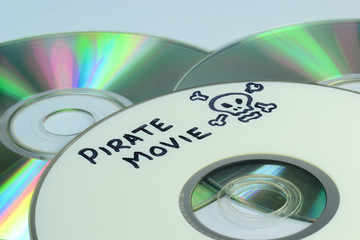 Piracy concept with Pirate Movie written on a dvd
