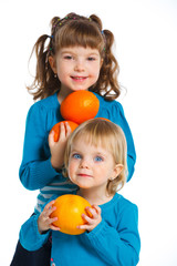 Happy girls with oranges