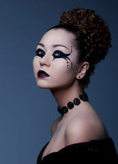 Fashion style - woman with dramatic theatrical makeup