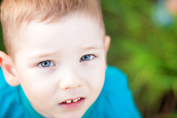Very beautiful child boy with blue eyes and funny two teeth