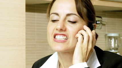Angry beautiful businesswoman fighting talking on the phone