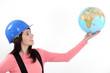 Tradeswoman holding up a globe