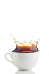 Splash of coffee in white cup
