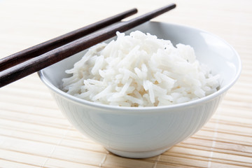 Long grain rice bowl with chopsticks
