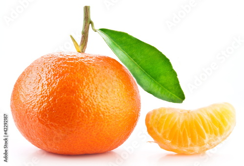 Tangerine and  its slice on white background.
