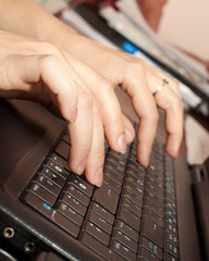 Hands on the keyboard closeup