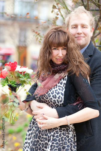 Dating couple with beautiful bright flowers