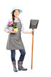 Full length portrait of a female worker holding a shovel