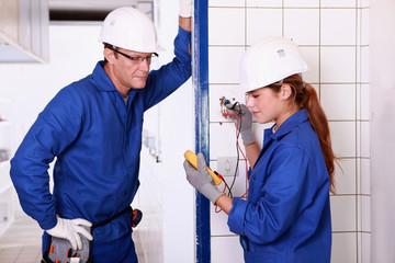 electricians taking measurements