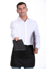 Waiter holding out two menus