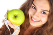 Woman with apple and centimeter