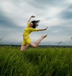 Brunette girl jumping in summer day. Outdoors potrrait