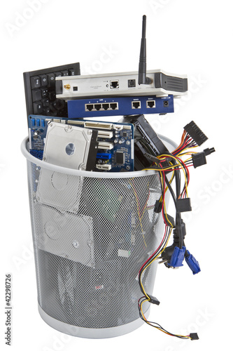 electronic scrap in trash can - 42298726