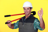 Man with bolt-cutters giving the OK sign
