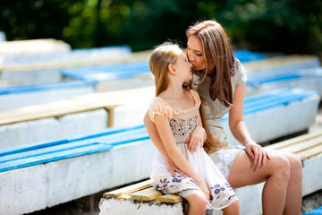 Mother and daughter playing in the park