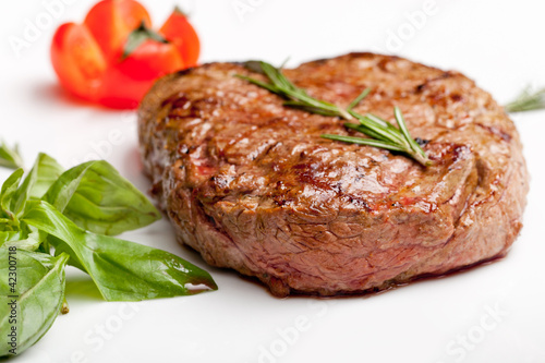 Grilled steak on a white plate