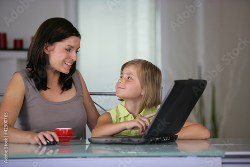 Mother and daughter using a  laptop
