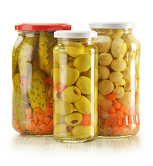 Three jars of pickled vegetables. Marinated food.