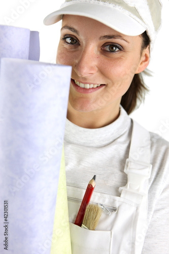 Woman holding selection of wallpaper